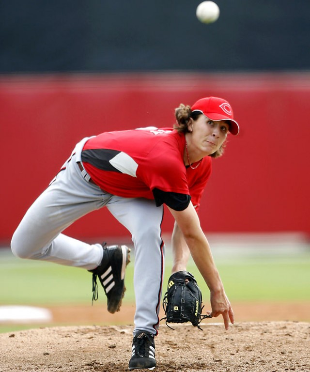 Reds pitcher Homer Bailey pitching motion follow through